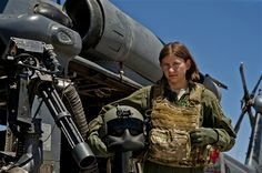 Air Force Airman 1st Class Natasha Libby, 66th Rescue Squadron aerial gunner, stands next to an HH-60 Pave Hawk helicopter at Nellis Air Force Base, Nev., June 20, 2013. Libby is the only female among more than 30 gunners assigned to the squadron. U.S. Air Force photo by Senior Airman Daniel Hughes