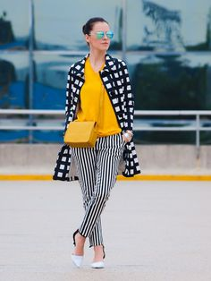 checkered coat with striped pants and yellow top