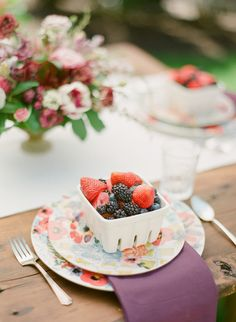 Berry baskets at each place setting, for a sweet outdoorsy, home theme.