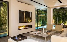 Living Room Designs with Fireplaces. 20 Luxury Living Room Designs with Fireplaces. Indoor Outdoor 200 Fireplace In A Living Room that Surrounds Modern Pools, Outdoor Living Design, Contemporary Fireplace, Fireplace Design, Modern Outdoor Living, Outdoor Gas Fireplace, Indoor Fireplace, Modern Fireplace, Indoor Outdoor Fireplaces