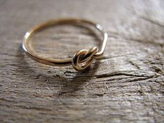 """Tying the knot ring. This would be a cute gift for bridesmaids, a """"thanks for helping us tie the knot"""" ring"""