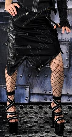 Apocalypse Skirt  Black Skirt with Contrast Grey Stitch Detail, X Belt Loops, Tattered Edges, Pleather Detail, a Zipper Front Pocket, 2 Back Pockets, a Snap Closure Pocket on the Lower Left, 2 Adjustable Buckles on the Right, Rivets, Grommets and a Diagonal Zipper Closure. See Matching Top Here: http://www.cryoflesh.com/shop/apocalypse-female-p-2682.html