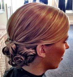 Sleek, side parted, low curled bridal updo