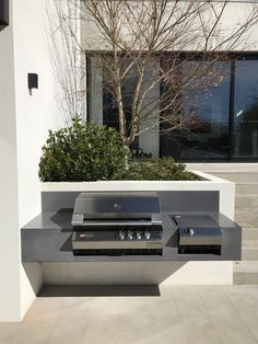 Floating concrete BBQ top by Mitchell Bink Concrete Design. Outdoor Bbq Kitchen, Patio Kitchen, Outdoor Kitchen Design, Outdoor Cooking, Outdoor Dining, Outdoor Spaces, Bbq Bar, Barbecue Area, Parrilla Exterior