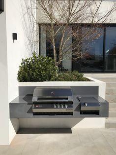 Floating concrete BBQ top by Mitchell Bink Concrete Design. www.mbconcretedesign.com.au