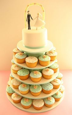 I loved my wedding cupcakes, and they were somewhat inspired by this photo. LOVE the topper!! So sweet.