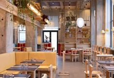 """The designers used warm colours and materials, which contrast the starkness of the building's concrete structure. They also added a wooden """"plant bridge"""" above the tables, so that greenery is visible everywhere. Custom Made Furniture, Bespoke Furniture, Furniture Making, Copenhagen Restaurants, Diner Booth, Burger Restaurant, Restaurant Offers, Paper Light, Restaurant Concept"""
