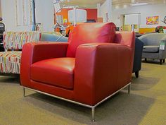 Red leather chair w/ polished steel trim and legs
