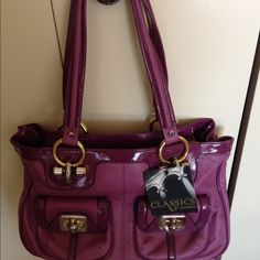Gorgeous authentic B. Makowsky leather handbag Plum leather handbag with gold tone hardware. Comes with dust bag. Bags
