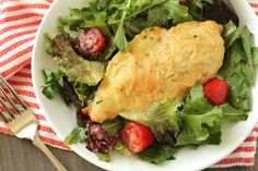 This offering, originally from Food And Wine, is an easy weeknight meal. I love it for its simplicity. Even though it is quick and easy, there is still great flavor due to the dijon, fresh thyme and parmesan. I love the lightly dressed salad which you can pile underneath each serving of chicken. If you like more dressing for your salad, by all means mix up a little extra!