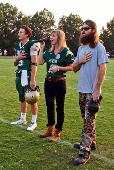 Reid, Missy and Jase as Missy sings the National Anthem