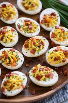 The BEST Deviled Eggs recipe! Made with a rich and creamy filling and includes ideas for various mix-ins and seasonings. A staple recipe!