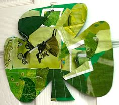 Collage of green magazine clippings, then cut into a clover, fun!  We did it in a red heart for St Valentine's Day, too. Tearing paper is always a hit with my toddler.