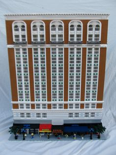 The Heron Building (1921), a Beaux Arts style building which fits stylistically in between the Baroque style and the sleeker Art Deco style.   In Los Angeles, California by architects Dodd and Richards.  LEGO Model by Tim Inman.