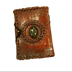 Center Stone Leather Diary with handmade paper and engraved leather art. Special Discounts for our wonderful followers. Use coupon code - TIS20  Visit - www.theindiansaint.com  #leatherwork #leatheraccessories #leatherproducts #leatherdiaries #leatherdiary #leatherwork #udaipur #rajasthan #handicraft #theindiansaint #tisstore #shopping #onlineshopping #journals