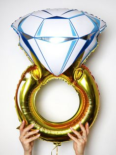 Flash your bridal bling in an even bigger way with an oversized engagement ring balloon for a fun bridal shower or bachelorette party decoration.
