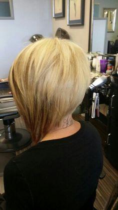 Blonde asymetrical bob haircut by Hristiana in Jacksonville,Fl