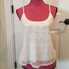Light cream crocheted tank top Never worn. Perfect condition. Cute with jeans or jean shorts. Size small. Tops Tank Tops
