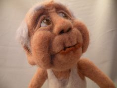Needle felted....love this face. http://www.myspace.com/feltalive/blog/463631747