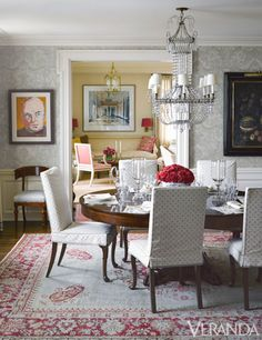 In the dining room, layered patterns, slipcovered chairs, and a mix of artwork give a new space lived-in elegance.