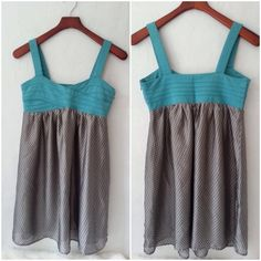 """Beautiful Dress Theme dress with turquoise colored bodice and purple & turquoise colored skirt on a creamy silver background. So pretty in person! Dress has a side zipper with hook & eye. Length is 26"""" down the side, Bust measures 15"""" across. New with Tags. Size is Medium, will fit Small as well. Theme Dresses Mini"""