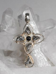 Natural Campo del Cielo Meteorite cross pendant suitable for men or women, with 5 organic-shaped Meteorite nuggets and 1 round faceted Black Onyx gemstone, bezel-set in 925-hallmarked Sterling Silver.