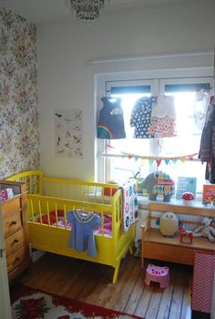 i love this colorful kiddo room. the yellow crib cheers it up!