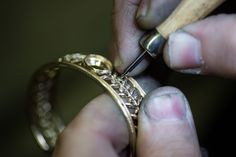 Stone setter rub over setting the diamonds in the bangle.  #bangle #stonesetting #timothyroe