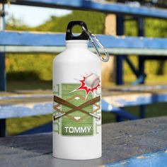 Kid's Sports Water Bottles - Baseball. They'll be staying hydrated in style with these fun Personalized Kid's Sports Water Bottles! Available in 8 different designs, these bottles are made of a sturdy eco-friendly aluminum material that stands up to the roughest, toughest kids! Includes the child's name and a handy clip for hanging on a belt or bag. The bottle holds 20 ounces and features a leak-proof cap and a handy clip/carabiner. Select sport and personalize with name of up to 15...