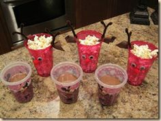 We used our Plastic Cup Rudolf craft to hold the popcorn, and I did opt for hot chocolate, but don't be afraid, I put sippy cup lids on them LOL!
