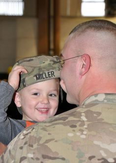 West Virginia National Guard Homecoming this past January! ADORABLE little one happy to see his Dad!     The West Virginia National Guard's 156th Military Police Detachment is welcomed home.