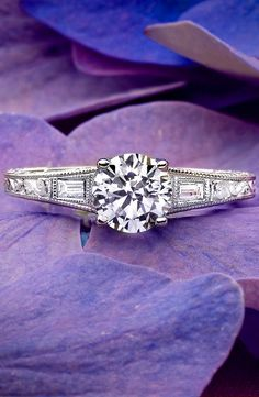 Love this antique-inspired ring featuring diamond accents.