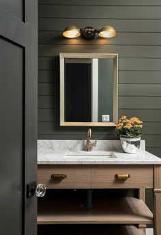 Powder room with shiplap walls Cabinetry is Red Oak and countertop is Carrara ma. Powder room with shiplap walls Cabinetry is Red Oak and countertop Shiplap Bathroom, Bathroom Black, Bathroom Cabinetry, Mirror Bathroom, Bathroom Marble, Neutral Bathroom, Bathroom Vanities, Industrial Wall Lights, Industrial Bathroom Lighting