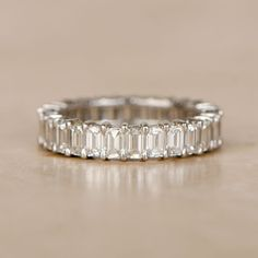 Estate Emerald Cut Eternity Band by EstateDiamondJewelry on Etsy https://www.etsy.com/listing/467270219/estate-emerald-cut-eternity-band