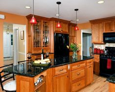 Modern kitchen with glass mosaic backsplash taupe floor