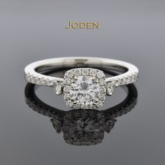 Diamond Halo Engagement Ring with Subtle Details. Designed with subtle details this .45 carat diamond halo engagement ring is perfect for the woman that loves modern style, yet still wants unique elements.