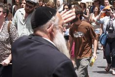 KEEP OUT OF SIGHT: An ultra-Orthodox Jew raised his hand to block his own view as Jerusalem's Slut Walk marched through downtown Jerusalem Friday. Mostly modestly dressed participants made a statement in the pious and sanctimonious city. (Nir Alon/Zuma Press)
