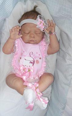 reborn baby  girl Hailey with moltted skin tones.