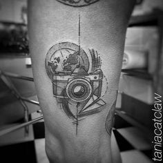 Sketch work style photo camera on the left thigh.