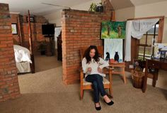 Grace works on the second floor of the original home, which includes an office and the Harshbargers' bedroom.