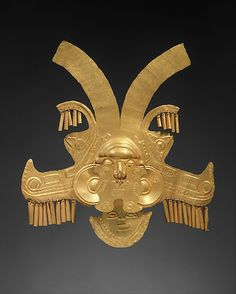 Headdress Ornament    Date:      1st–7th century  Geography:      Colombia  Culture:      Calima (Yotoco)  Medium:      Gold  Dimensions:      H. 10 x W. 9 3/8 in. (25.4 x 23.8 cm)   Classification:      Metal-Ornaments