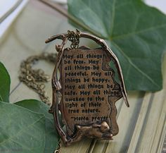 Loving Kindness Metta Prayer Quotation Handmade Necklace Pendant in bronze with chain. (Etsy)