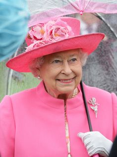 Queen Elizabeth II shelters from the rain under an umbrella during the first Royal Garden Party of the year in the grounds of Buckingham Palace on May 10, 2016 in London, England.