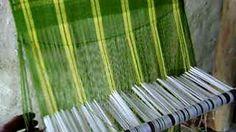 short video by Labbé Aurélie demonstrating weaving on a warp weighted loom