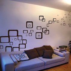 Really love the idea of wall decals for the living room, since it's such a small space. But since I might be the only girl here, I've got to look into more masculine decals. This could be really nice.
