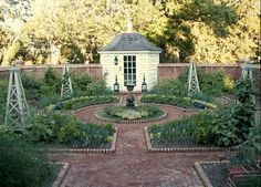 Like the layout of this potager, though I'd replace the shed with a chicken coop and brick paths with hazelnut shells.