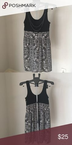 Black and white dress with attached necklace Really cute black and white dress with attached necklace Express Dresses
