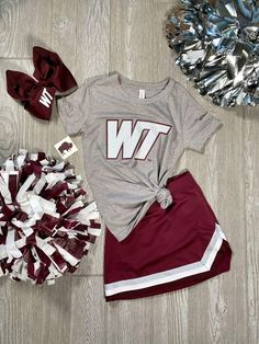 Youth girls maroon and silver cheer skirt. - 90/10 polyester/spandex knit - 100% polyester double knit contrasting front panel - Three-color rib trim at V-neck, shoulder, and waist - Double-needle hemmed bottom Cheerleading Picture Poses, Cheerleading Shirts, Cheer Poses, Cheer Shirts, Camp Shirts, Cheer Uniforms, Cheer Outfits, Cute Casual Outfits, Youth Cheer