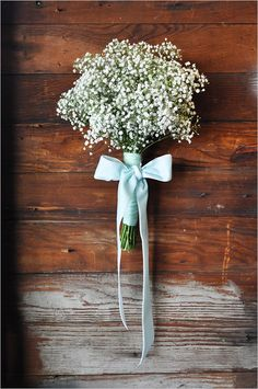 Just baby's breath for bridesmaid then baby's breath and a few white roses for bride