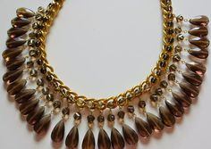 Learn how to make wire wrap jewelry and create a stunning homemade necklace with this tutorial for the Dazzling Drop Bead Statement Necklace.